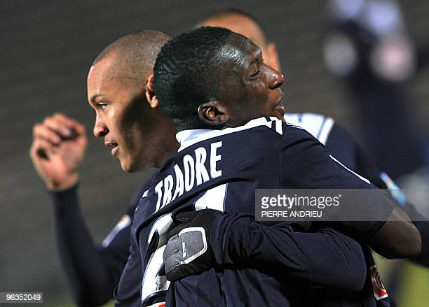 Bordeaux's forward Yoan Gouffran and Abdou Traore celebrate after a goal during the French League cup football match Bordeaux vs Sedan on February 2...