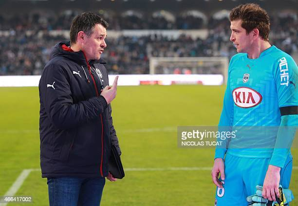 Bordeaux's French coach Willy Sagnol speaks with Bordeaux's goalkeeper Cedric Carrasso during the French L1 football match between Bordeaux and Paris...