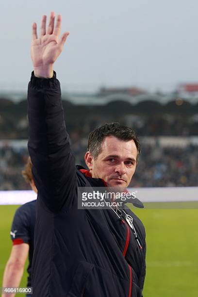 Bordeaux's French coach Willy Sagnol waves to the fans at the end of the French L1 football match between Bordeaux and Paris on March 15 2015 at the...