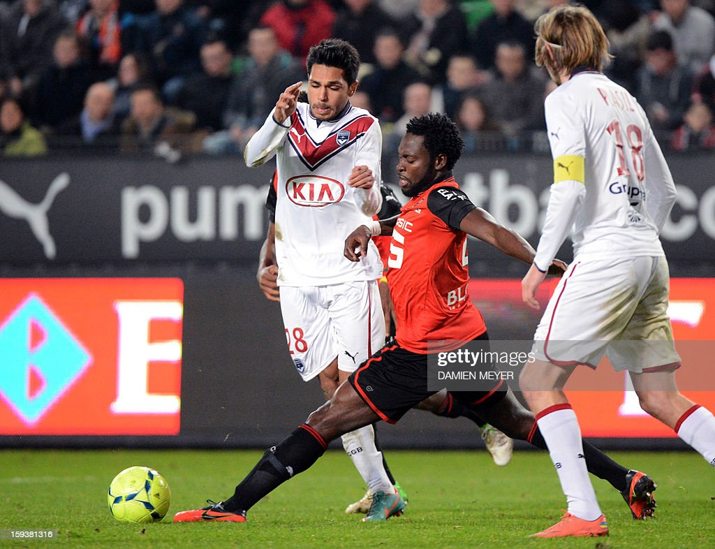 Bordeaux's French defender Benoit Tremoulinas (L) fights for the ball with Rennes' Nigerian defender Onyekachi Apam during a French L1 football match between Rennes and Bordeaux on January 12, 2013 at the route de Lorient stadium in Rennes, western France.