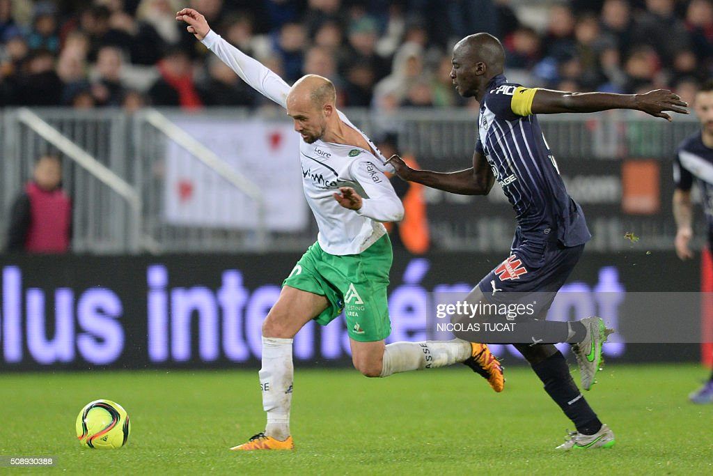 Bordeaux's French defender Cedric Yambere (R) vies with Saint-Etienne's French midfielder Renaud Cohade during the French Ligue 1 football match between Bordeaux and Saint-Etienne at Matmut Atlantique Stadium in Bordeaux, southwestern France, on February 7, 2016 . AFP PHOTO / NICOLAS TUCAT / AFP / NICOLAS TUCAT