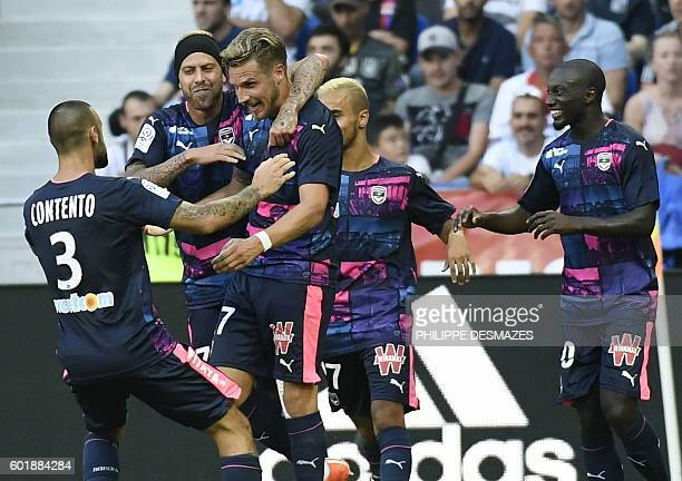 Bordeaux's French defender Gregory Sertic celebrates with his teammates after scoring his team's second goal during the French L1 football match Lyon...