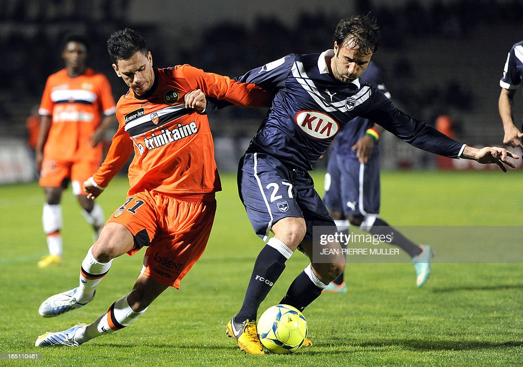 Bordeaux's French defender Marc Planus (R) vies with Lorient's French forward Jeremie Aliadiere during the French L1 Football match Bordeaux vs. Lorient on March 30, 2013 at the Chaban-Delmas Stadium in Bordeaux, southwestern France. AFP PHOTO / JEAN-PIERRE MULLER