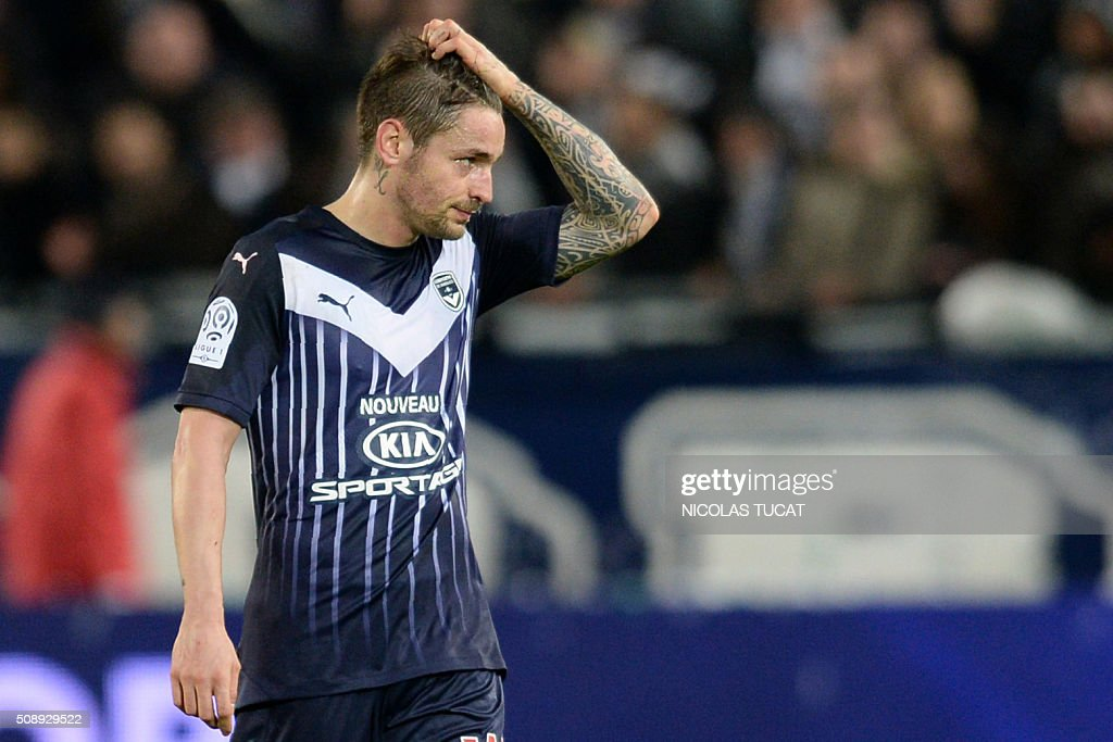 Bordeaux's French defender Mathieu Debuchy reacts during theFrench Ligue 1 football match between Bordeaux and Saint-Etienne at Matmut Atlantique Stadium in Bordeaux, southwestern France, on February 7, 2016 . AFP PHOTO / NICOLAS TUCAT / AFP / NICOLAS TUCAT