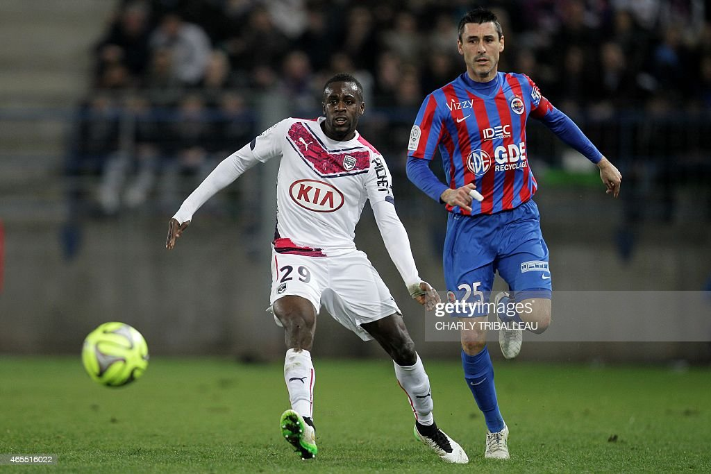 Bordeaux's French defender Maxime Poundje vies for the ball with Caen's French midfielder Julien Feret during the French L1 football match between...