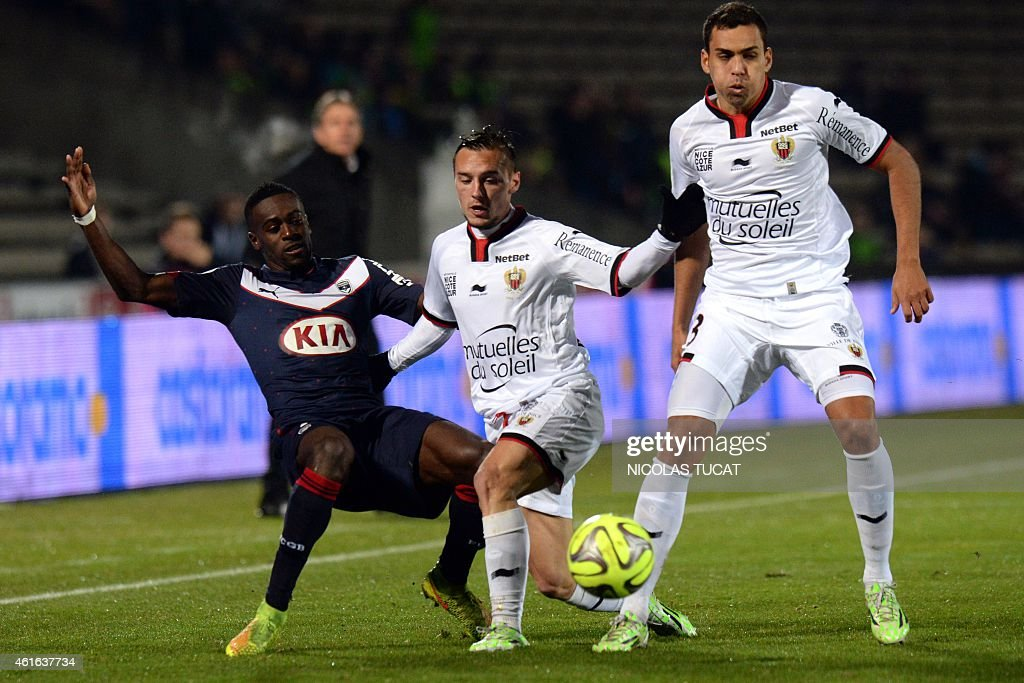 Bordeaux's French defender Maxime Poundje (L) vies for the ball with Nice's French midfielder Eric Bautheac (C) and Brazilian midfielder Carlos Eduardo (R) during the French L1 football match between Bordeaux (FCGB) and Nice (OGCN) on January 16, 2015 at the Chaban-Delmas stadium in Bordeaux, southwestern France.