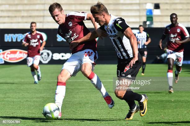 Bordeaux's French defender Maxime Poundje vies for the ball with Angers' Belgian forward Baptiste Guillaume during the French L1 football match...