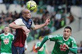 Bordeaux's French defender Nicolas Pallois vies with St Etienne's Turkish forward Mevlut Erding during the French L1 football match between Girondins...
