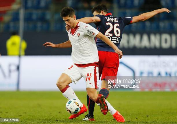 Bordeaux's French defender Theo Pellenard vies for the ball with Caen's Croatian forward Ivan Santini during the French L1 football match between...
