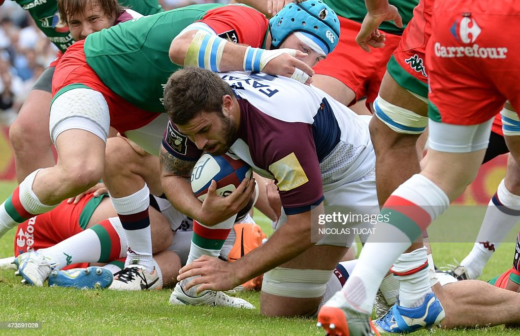 Bordeaux's French flanker Marco Tauleigne goes to score a try during the French Top 14 rugby union match between BordeauxBegles and Bayonne on May 16...