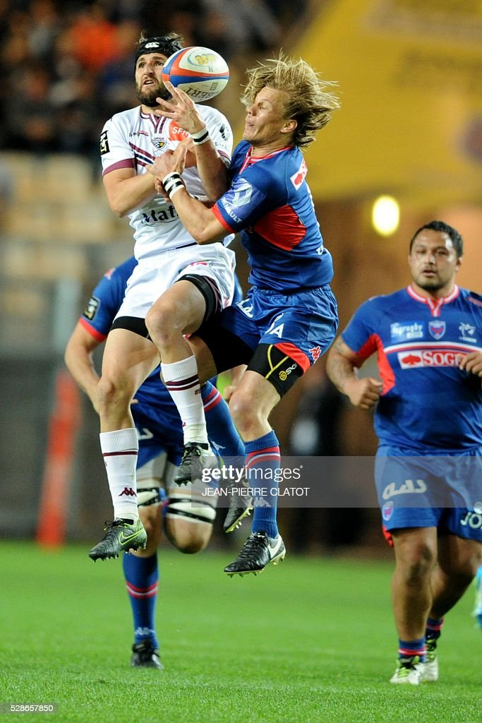Bordeaux's French flyhalf Romain Lonca (L) vies with Grenoble's South African scrumhalf Charl Mcleod (R) during the French Top 14 rugby union match between Grenoble and Bordeaux Begles on may 6, 2016 at the Stade des Alpes in Grenoble, southeastern France.