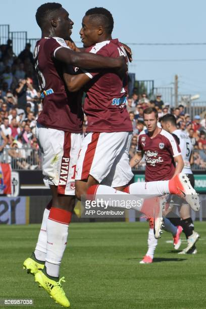 Bordeaux's French forward Alexandre Mendy celebrates with Bordeaux's Guinean forward Francois Kamano after scoring a goal during the French L1...
