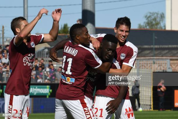Bordeaux's French forward Alexandre Mendy celebrates with Bordeaux's Guinean forward Francois Kamano and Bordeaux's French defender Theo Pellenard...