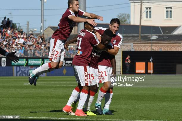 Bordeaux's French forward Alexandre Mendy celebrates with Bordeaux's Guinean forward Francois Kamano Bordeaux's French defender Theo Pellenard and...