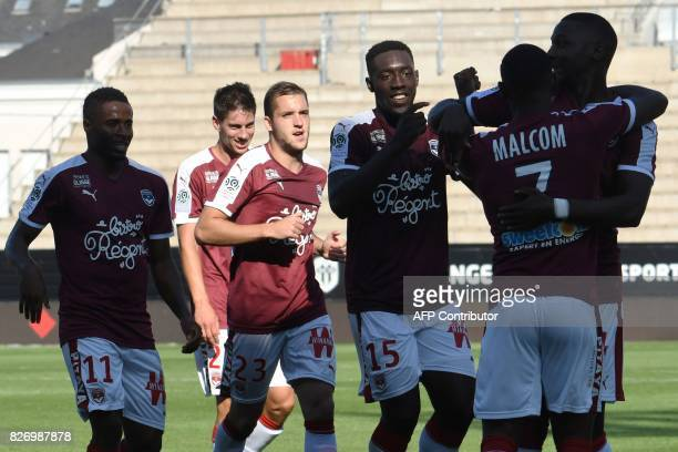 Bordeaux's French forward Alexandre Mendy celebrates with teammates after scoring a goal during the French L1 football match between Angers and...
