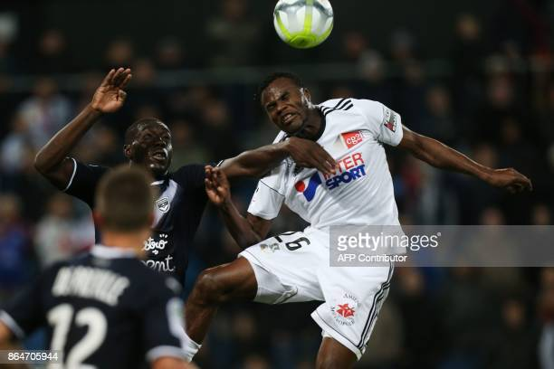 Bordeaux's French forward Alexandre Mendy vies for the ball with Amiens' Cameroonian midfielder Guy Ngosso during the French L1 football match...