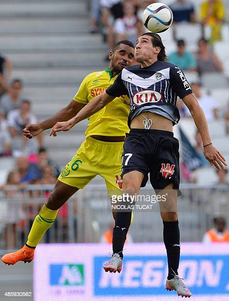 Bordeaux's French forward Enzo Crivelli vies with Nantes' Frenchborn Senegalese midfielder Remi Gomis during the French Ligue 1 football match...