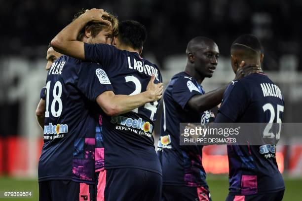 Bordeaux's French forward Gaetan Laborde is congratuled by teamates after scoring a goal during the French L1 football match between AS SaintEtienne...