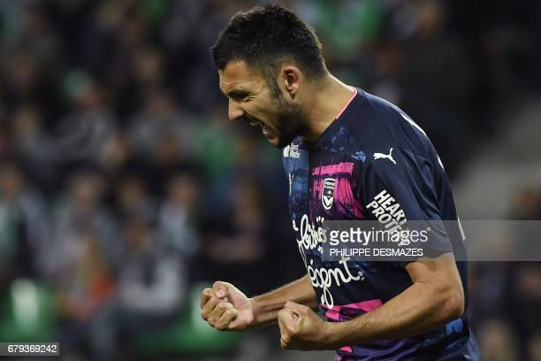Bordeaux's French forward Gaetan Laborde reacts after scoring a goal during the French L1 football match between AS SaintEtienne and FC Girondins de...