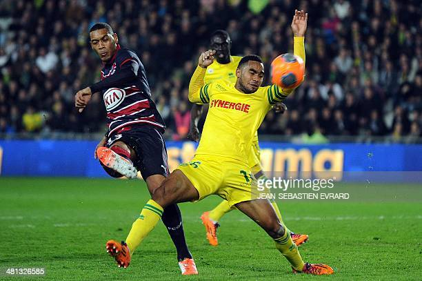 Bordeaux's French forward Guillaume Hoarau manages to shoot despite Nantes' French defender Koffi Djidji during the French L1 football match between...