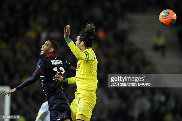 Bordeaux's French forward Guillaume Hoarau vies with Nantes' Venezuelian defender Osvaldo Vizcarrondo during the French L1 football match Nantes vs...