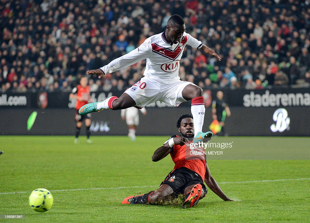 Bordeaux's French forward Henri Saivet (top) avoids a tackle by Rennes' Nigerian defender Onyekachi Apam during a French L1 football match Rennes against Bordeaux on January 12, 2013 at the route de Lorient stadium in Rennes, western France.