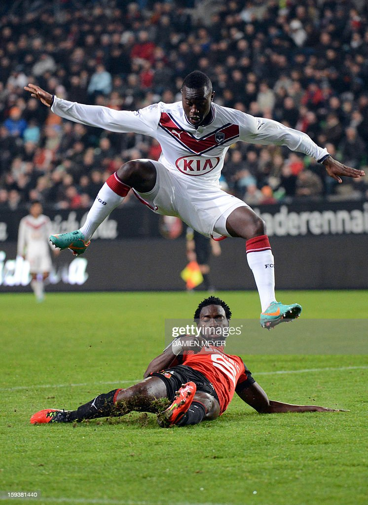 Bordeaux's French forward Henri Saivet (Top) jumps over Rennes' Nigerian defender Onyekachi Apam during the French L1 football match between Rennes and Bordeaux on January 12, 2013, at the Route de Lorient stadium in Rennes, western France.
