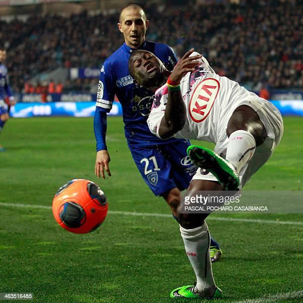 Bordeaux's French forward Henri Saivet vies with Bastia's Algerian defender Fethi Harek during the French L1 football match Bastia against Bordeaux...