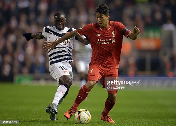 Bordeaux's French forward Henri Saivet vies with Liverpool's Brazilian midfielder Roberto Firmino during a UEFA Europa League group B football match...