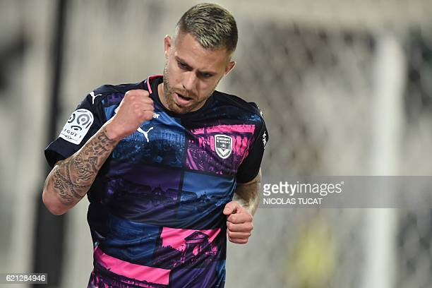 Bordeaux's French forward Jeremy Menez celebrates after scoring a goal during the French L1 football match between Bordeaux and Lorient on November 5...