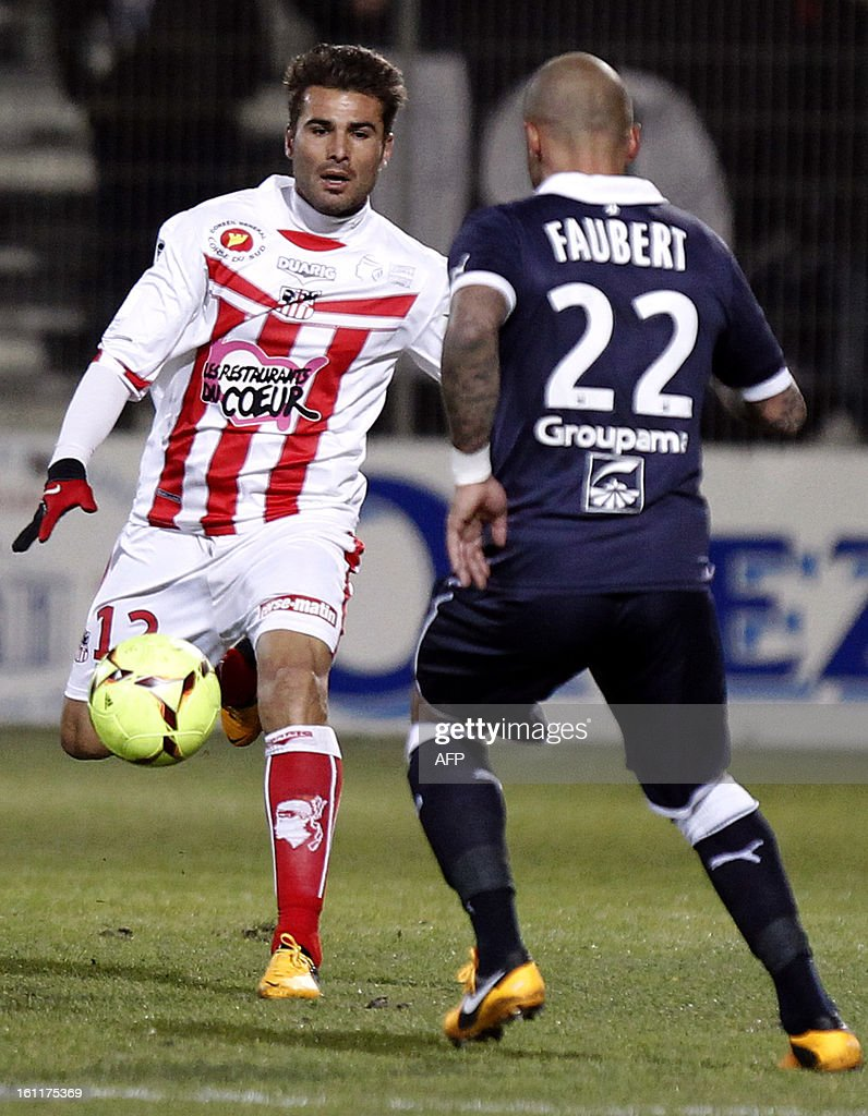 Bordeaux's French forward Julien Faubert (R) vies with Ajaccio's Romanian forward Adrian Mutu during a French L1 football match between Ajaccio (ACA) and Bordeaux (GDB) at Francois Coty stadium in Ajaccio, Corsica, on February 9 , 2013.