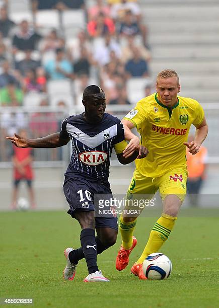 Bordeaux's French forward Thomas Toure vies with Nantes' Icelandic forward Kolbeinn Sigthorsson during the French Ligue 1 football match between...