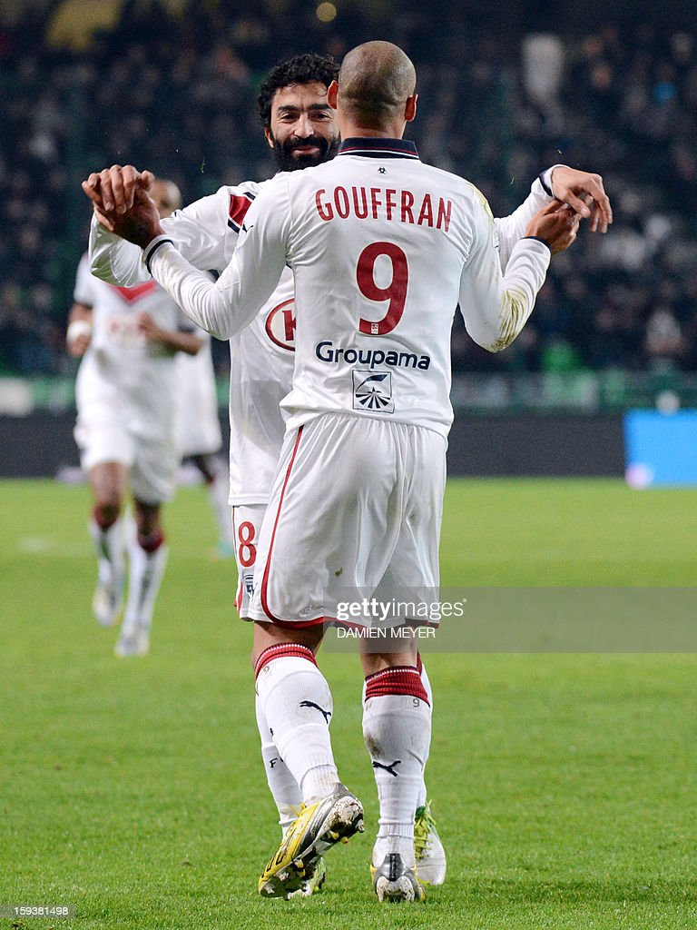 Bordeaux's French forward Yoan Gouffran (R) celebrates with a teammate after scoring a goal during the French L1 football match between Rennes and Bordeaux on January 12, 2013, at the Route de Lorient stadium in Rennes, western France.