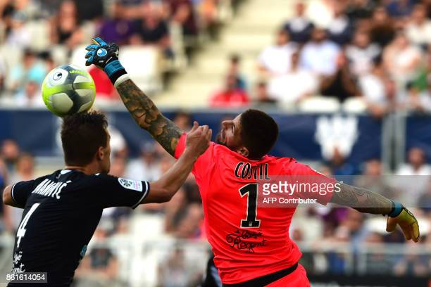 Bordeaux's French goalkeeper Benoit Costil jumps for the ball during the French Ligue 1 football match between Bordeaux and Nantes on October 15 2017...