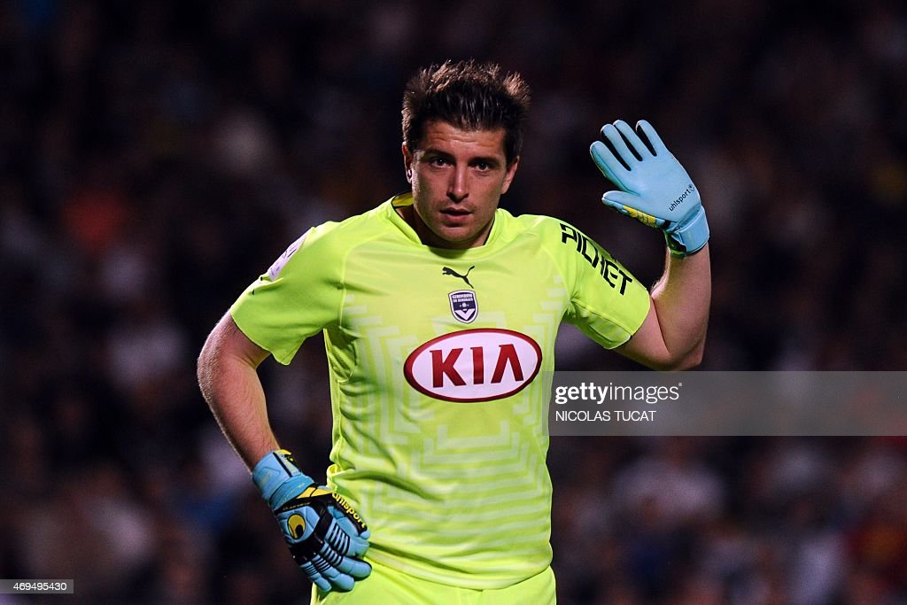 Bordeaux's French goalkeeper <a gi-track='captionPersonalityLinkClicked' href=/galleries/search?phrase=Cedric+Carrasso&family=editorial&specificpeople=661919 ng-click='$event.stopPropagation()'>Cedric Carrasso</a> gestures during the French L1 football match between Girondins de Bordeaux (FCGB) and Marseille (OM) on April 12, 2015 at the Chaban-Delmas stadium in Bordeaux, southwestern France.