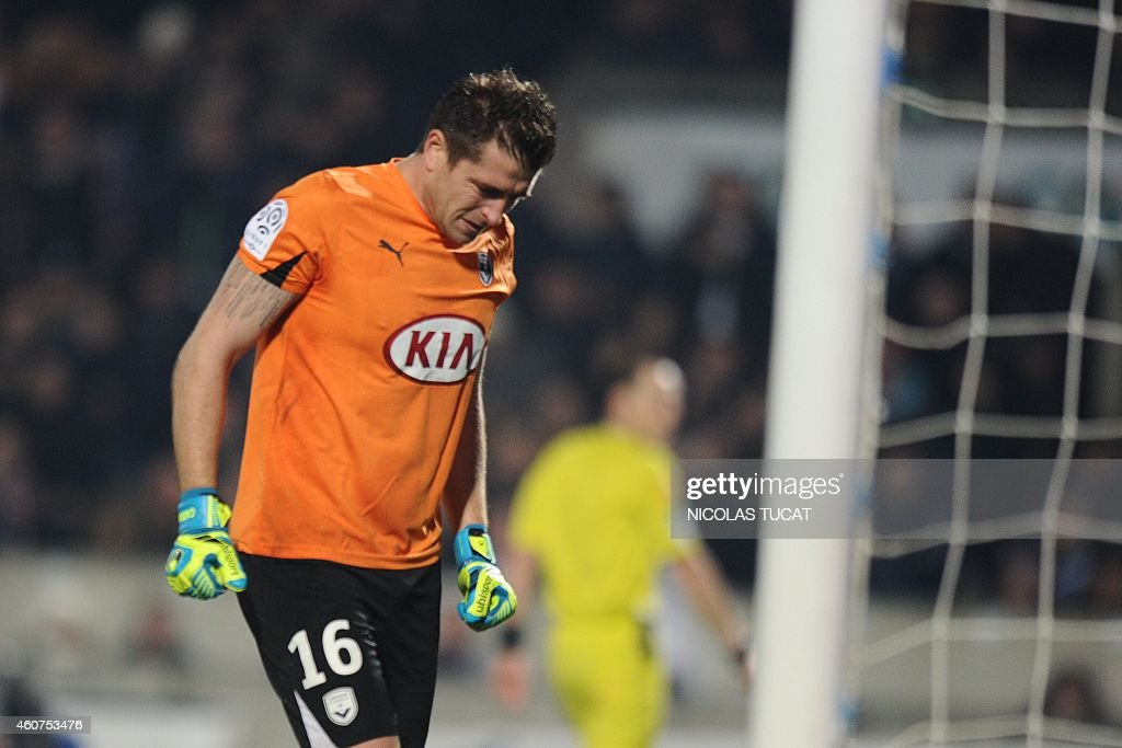 Bordeaux's French goalkeeper <a gi-track='captionPersonalityLinkClicked' href=/galleries/search?phrase=Cedric+Carrasso&family=editorial&specificpeople=661919 ng-click='$event.stopPropagation()'>Cedric Carrasso</a> reacts during the French L1 football match between Girondins de Bordeaux (FCGB) and Lyon (OL) on December 21, 2014 at the Chaban-Delmas stadium in Bordeaux, southwestern France.