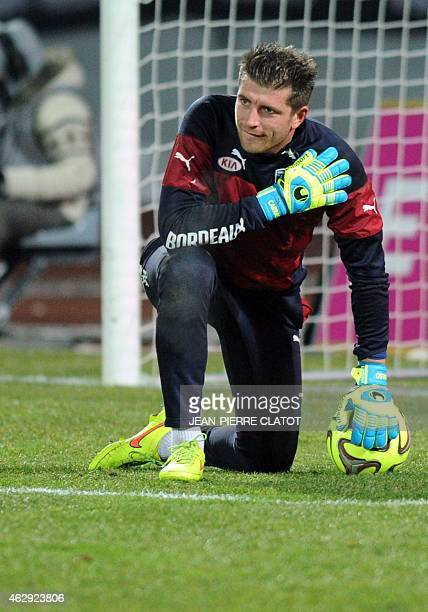 Bordeaux's French goalkeeper Cedric Carrasso warms up prior to the French L1 football match Evian vs Bordeaux on February 7 2015 at the Parc des...