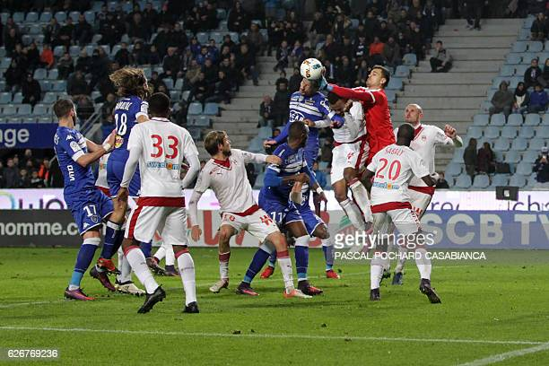 Bordeaux's French goalkeeper Jerome Prior boxes the ball in front of Bastia's Algerian midfielder Mehdi Mostefa during the French L1 football match...