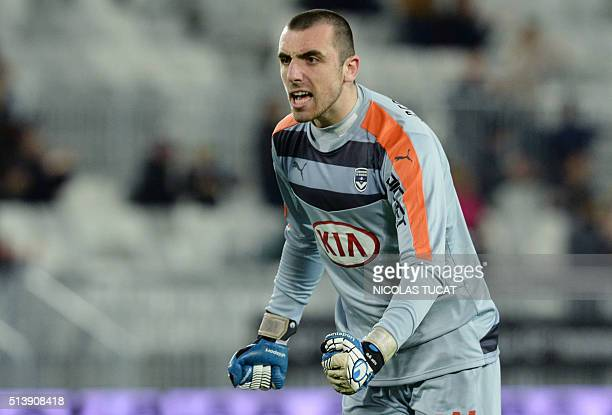 Bordeaux's French goalkeeper Paul Bernardoni reacts after his team mate scored a goal during the French L1 football match between Bordeaux and...