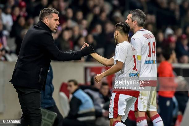 Bordeaux's French head coach Jocelyn Gourvennec congratulates Bordeaux's FrenchAlgerian midfielder Adam Ounas after he scored a goal during the...