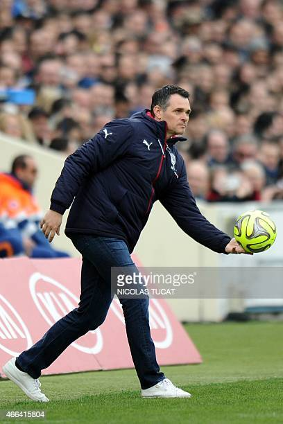 Bordeaux's French head coach Willy Sagnol throws the ball during the French L1 football match between Bordeaux and ParisSaintGermain on March 15 2015...