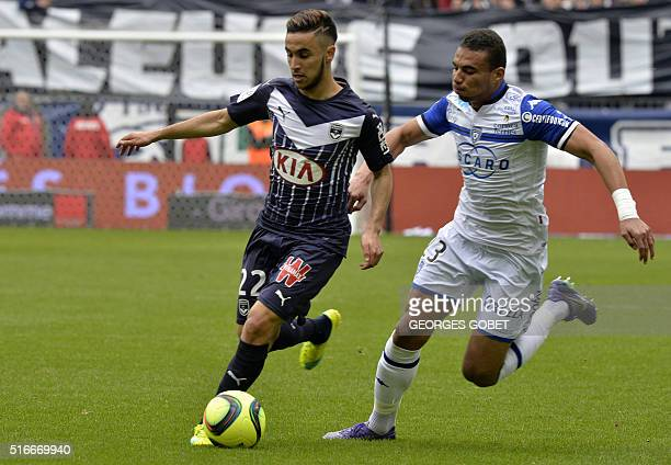 Bordeaux's French midfielder Adam Ounas and Bastia's French defender Alexander Djiku play the ball during the French L1 football match between FC...
