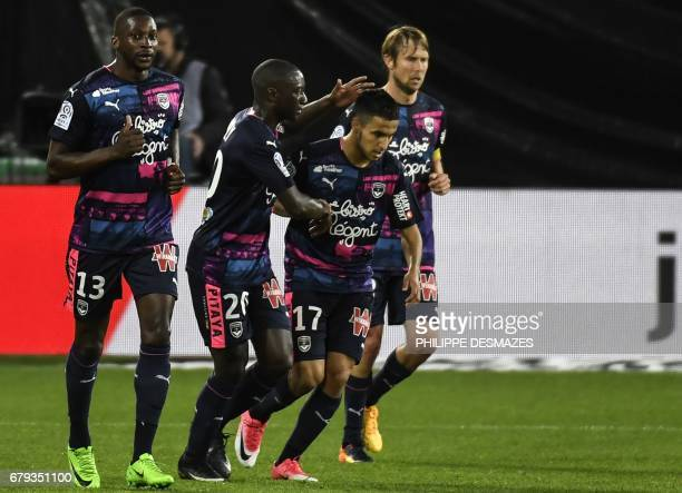 Bordeaux's French midfielder Adam Ounas celebrates with his teammates after scoring a goal during the French L1 football match between AS...