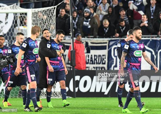 Bordeaux's French midfielder Adam Ounas congratulates Bordeaux's French forward Gaetan Laborde who scored his team's two goals at the French Cup...