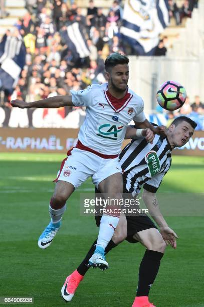 Bordeaux's French midfielder Adam Ounas vies for the ball against Angers' French midfielder Pierrick Capelle during the quarter final French Cup...