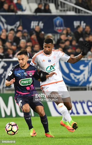 Bordeaux's French midfielder Adam Ounas vies with Lorient's Carlos Ribeiro during the French Cup football match between FCG Bordeaux and FC Lorient...