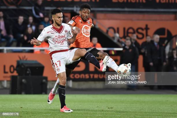 Bordeaux's French midfielder Adam Ounas vies with Lorient's French defender Steven Moreira during the French L1 football match between Lorient and...