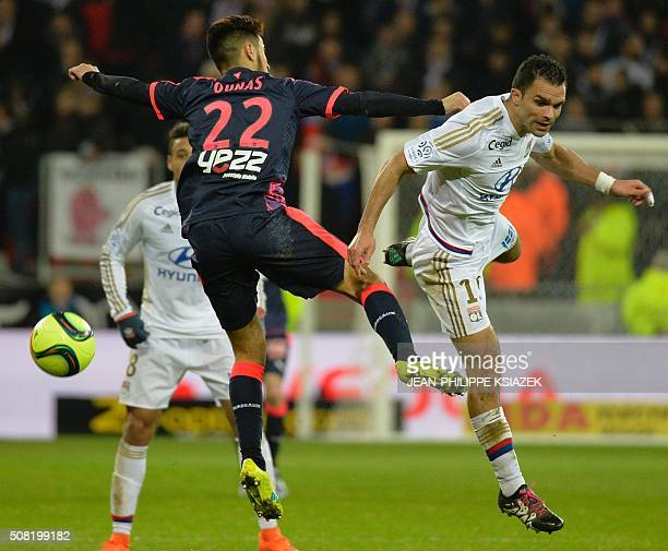 Bordeaux's French midfielder Adam Ounas vies with Lyon's French defender Jeremy Morel during the French L1 football match Lyon vs Bordeaux on...