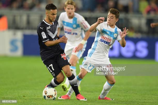 Bordeaux's French midfielder Adam Ounas vies with Marseille's French midfielder Maxime Lopez during the French L1 football match between Bordeaux and...