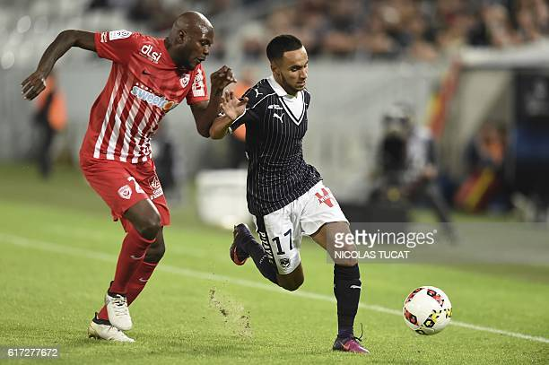 Bordeaux's French midfielder Adam Ounas vies with Nancy's defender Erick Cabaco during the French Ligue 1 football match between Bordeaux and Nancy...